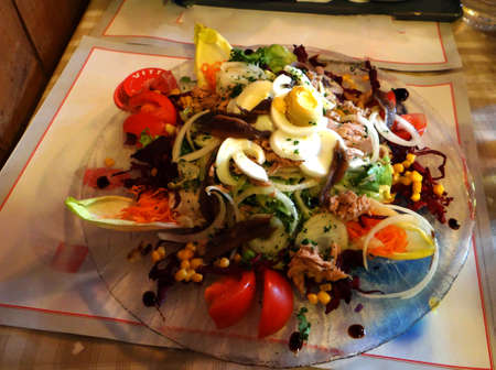 Salade Nicoise at a small alpine restaurant in Les Lindarets, France Stock Photo