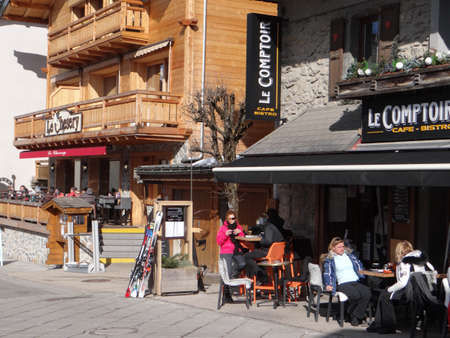 CHATEL, FRANCE - FEB 20, 2018 - Skiers having lunch outdoors at a restaurant in small alpine village of Chatel, France Editöryel