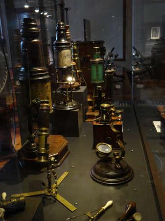 GENEVA, SWITZERLAND - FEB 24, 2018 - Vintage microscopes on display at the History of Science Museum in Geneva, Switzerland