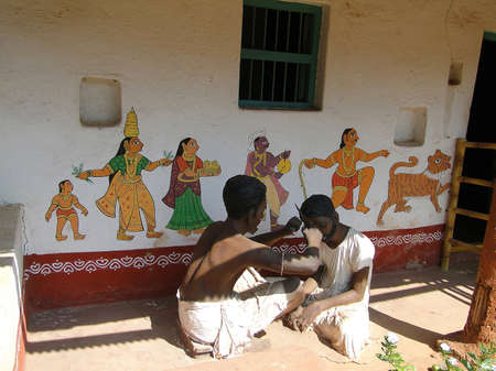 HYDERABAD, INDIA - NOV 23 - Mannequins and tribal designs painted on wall, Hyderabad, Andhra Pradesh, India, Asia