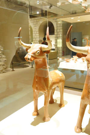 ANKARA, TURKEY - MAY 21, 2014 -  Hittite long horn bull sculptures,  from  Alaca, Corum, 1400 BCE Museum of Anatolian Civilization, Ankara, Turkey