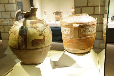 ANKARA, TURKEY - MAY 21, 2014 -  Ancient pottery with animals and hunting scenes,  from  Alaca, Corum, 1400 BCE Museum of Anatolian Civilization, Ankara, Turkey Editorial