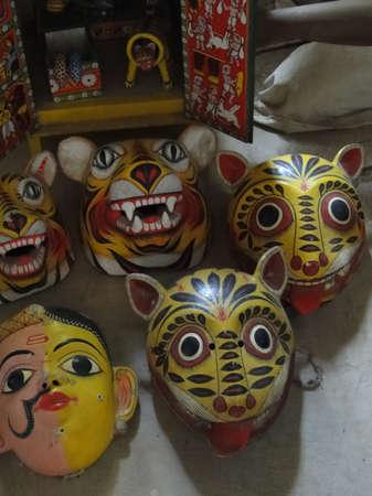HYDERABAD, INDIA - NOV 23, 2009 -   Colorful tribal masks in folk art garden in Hyderabad, Andhra Pradesh, India, Asia Editorial
