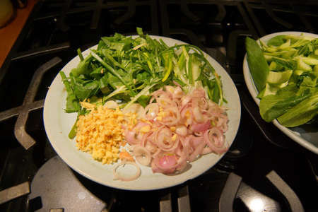 Greens, ginger and shallot prepared for stir fry cooking, Seattle Archivio Fotografico - 97874547