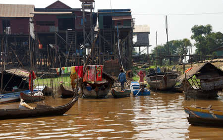 Stilt houses and boats during dry season at the Kompong Kleang floating fishing village,  Cambodia Editorial
