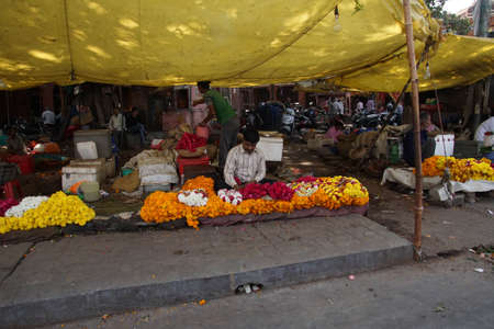 JAIPUR, INDIA - OCT 8, 2017 - Flower sellers prepare for the Divaali holiday in  outside Govind Devji Temple,  Jaipur, Rajasthan, India