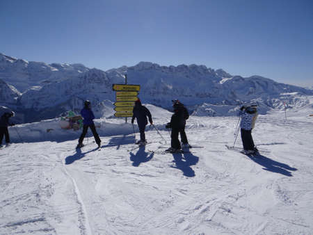 Silhouettes of skiers high in the Portes du Soleil near Champoussin, Switzerland