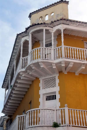 Yellow ochre colonial building with white balconies  in old town colonial Cartagena, Colombia Editorial
