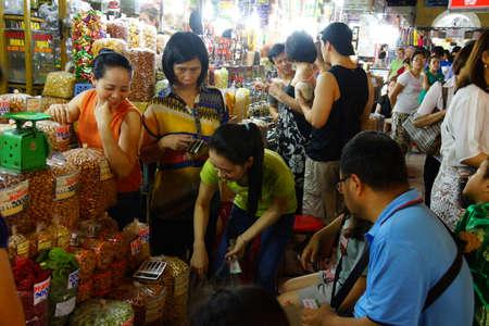 SAIGON - FEB 4, 2015 - Buying food  at the Ben Thanh market, Saigon (Ho Chi Minh City),  Vietnam Editorial