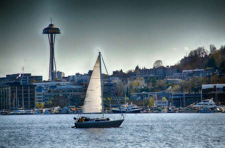 Sailboat and Seattle skyline with landmark Space Needle from Lake Union, Seattle, Washington