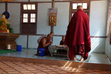 KYAUKME, MYANMAR - FEB 21, 2015 - Buddhist monks eating their main meal of the day at noon, Kyaukme Myanmar (Burma) 報道画像
