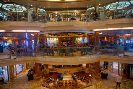 MEDITERRANEAN SEA - APR 17, 2018 - Open central atrium on a cruise ship in the Mediterranean Sea Archivio Fotografico - 100954624