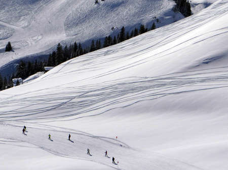 Fresh ski tracks in the Portes du Soleil near Champoussin, Switzerland Stock Photo - 100968771