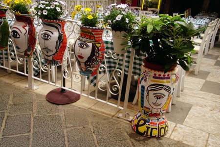 TAORMINA, ITALY- APR 18, 2018 - One-eyed face urns decorate the street of Taormina Sicily, Italy Éditoriale