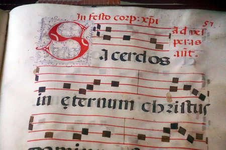 TAORMINA, ITALY- APR 18, 2018 - Illuminated manuscript in  the  Treasury of  St Pauls Cathedral, Taormina Sicily, Italy