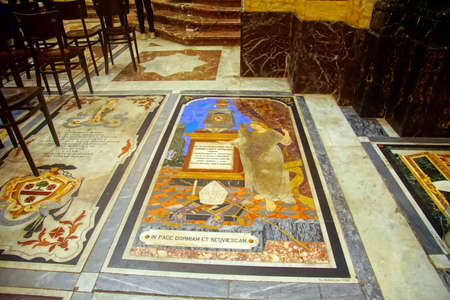 TAORMINA, ITALY- APR 18, 2018 - Tombstone of inlaid marble in floor of St Pauls Cathedral, Taormina Sicily, Italy