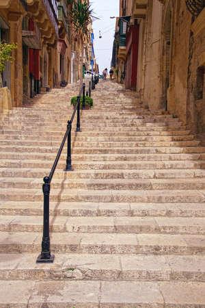 Steep steps on a narrow street in , Valletta, Malta