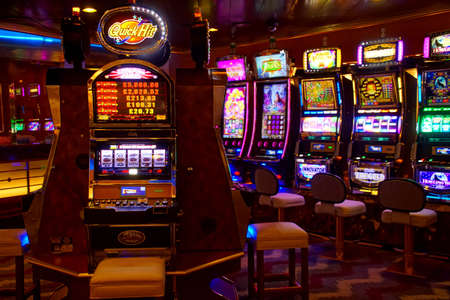 MEDITERRANEAN SEA - APR 13, 2018 - Slot machines of the casino on a cruise ship in the Mediterranean Sea