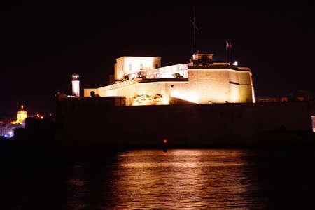 Nighttime illumination of Fort Saint Angelo, in the  Grand Harbor of Valletta, Malta