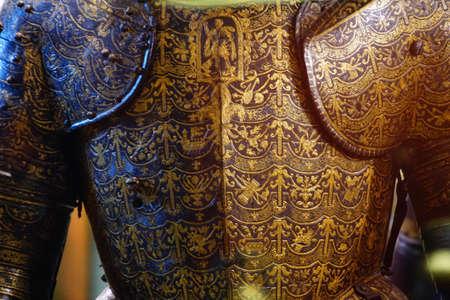 VALLETTA, MALTA - APR 11, 2018 - Detail of gilt tournament armor, Palace Armoury, Valletta, Malta