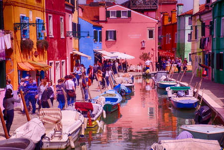 BURANO, ITALY - APR 16, 2018 - Brightly colored houses of Burano Venice, Italy Editorial
