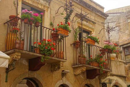 Decorated balconies on the main street of Taormina Sicily, Italy