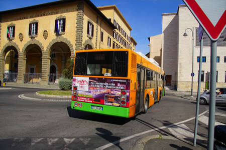 LIVORNO, ITALY - APR 23, 2018 - Local bus passing the Loggia of the Chamber of  Commerce, Livorno, Italy