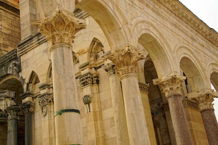 Acanthus Corinthian capitals on limesttone pilasters in Peristyle courtyard of Diocletians Palace, Split, Croatia