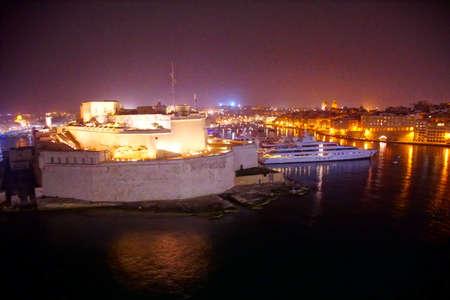 Grand Harbor and night lights of  Fort Saint Angelo, Valletta, Malta