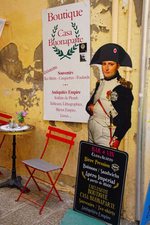 AJACCIO, CORSICA - APR 24, 2018 - Napoleon souvenirs and posters outside his birthplace in Ajaccio Corsica, France Redakční