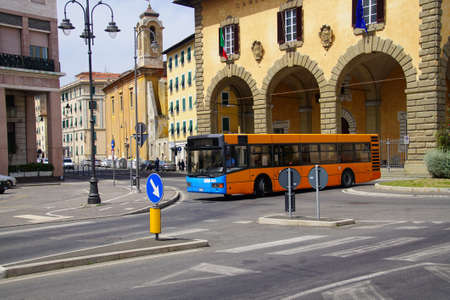 LIVORNO, ITALY - APR 23, 2018 - Local bus passing the Loggia of the Chamber of  Commerce, Livorno, Italy Stock Photo - 101634099