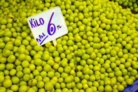 Sour green plums in the central market of Canakkale, Turkey