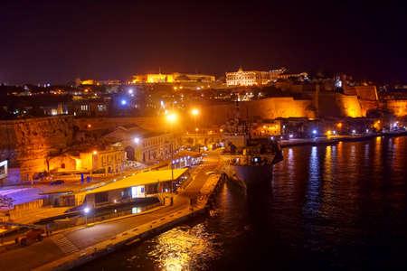 Grand Harbor and night lights of  city fortifications Valletta, Malta