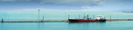 Panorama of oil tanker anchored at the breakwater of the port of Livorno, Italy