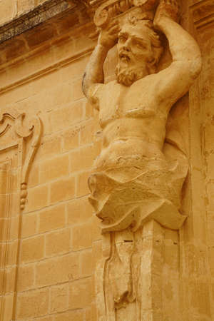 Statues on the exterior of the Cathedral Treasury museum in Mdina, Malta