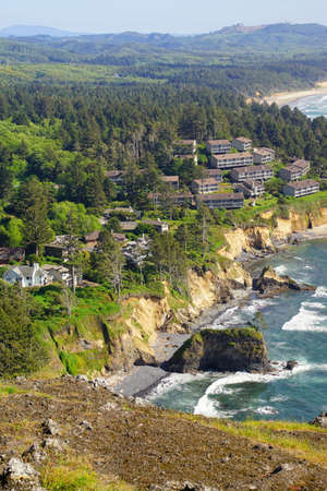 Condominiums spread from conifer forest across headlands at Otter Rock near Depoe Bay, Oregon