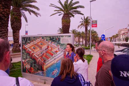 SPLIT, CROATIA - APR 15, 2018 - Tour guide explaining map of  Roman Emperor Diocletians Palace, Split, Croatia Editorial