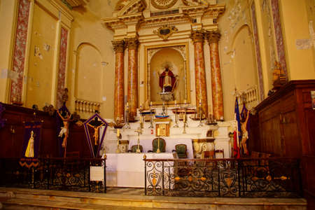 AJACCIO, CORSICA - APR 24, 2018 - Altar with ship models in the Mariner's chapel, St Erasmus Church,