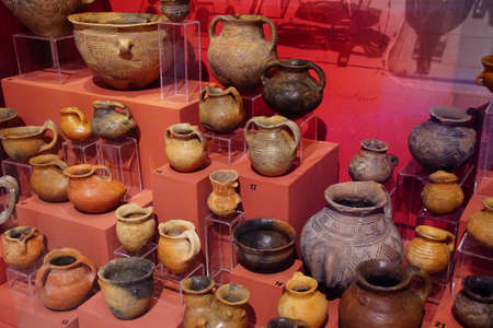 VALLETTA, MALTA - APR 11, 2018 - Neolithic pottery jars and urns, Archaeological Museum,Valletta, Malta