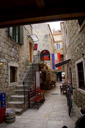 TROGIR, CROATIA - APR 15, 2018 - Narrow medieval street of Trogir, Croatia
