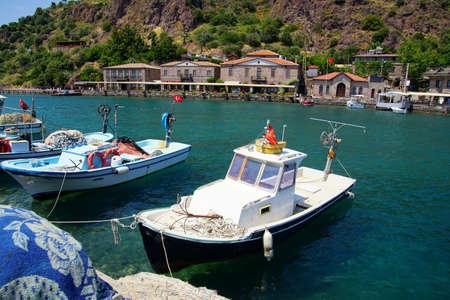 Small fishing boats anchored in the marina of Behramkale Assos, Turkey
