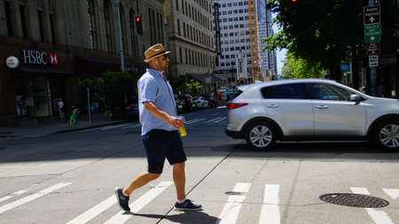 SEATTLE - JUL 15, 2018 - Pedestrian crossing the street in downtown Seattle, Washington
