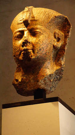 MUNICH - JUL 21, 2018 - Head from a statue of the queen Hatshepsut dressed in regal headdress of the pharaoh, Egyptian Museum, Munich, Germany