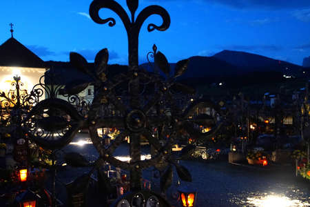 CASTELROTTO, ITALY - JUL 25, 2018 - Candles light the headstones in the village cemetery in Castelrotto - Kastelruth, Italy
