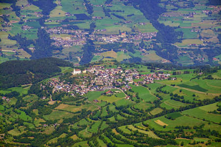 Aerial view of small village in the foothills of the Dolomites Alps, Italy