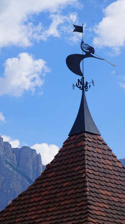 Weather vane on house in alpine village of Castelrotto - Kastelruth, Italy