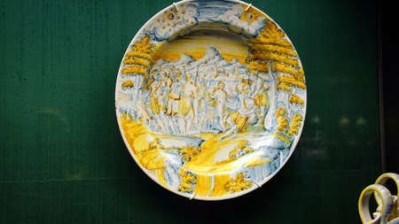 MUNICH - JUL 22, 2018 - Baroque faience plate from the 16th century in the Bavarian National Museum, Munich, Germany