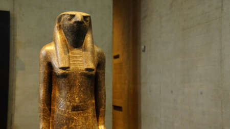 MUNICH - JUL 21, 2018 - Standing striding figure of the god Horus, Egyptian Museum, Munich, Germany