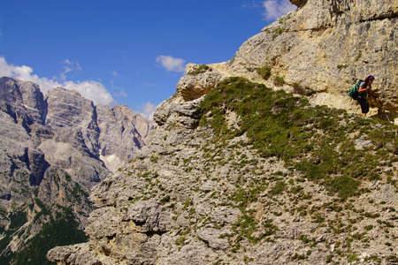 Hikers on steep trail up Monte piana, Dolomites Alps, Italy