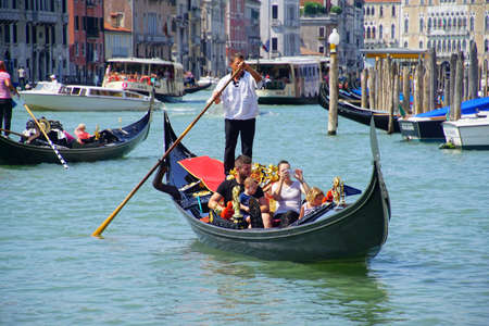 VENICE, ITALY - AUG 12, 2018 - Gondola with tourists on the Grand Canal Venice, Italy